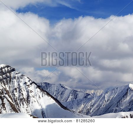 Winter Snowy Mountains In Clouds At Nice Day