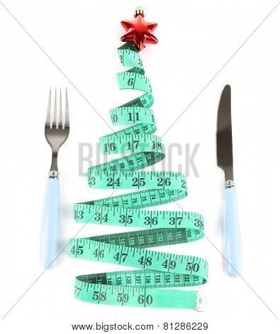 Measuring tape and cutlery with Christmas decoration isolated on white