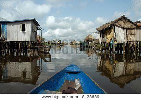 Canoeing Through African Village