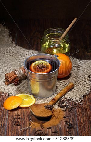 Preparation Of Mulled Wine With Addition Of An Orange, Honey, Cinnamon, A Carnation And An Anise