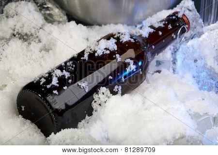 Frozen bottle of beer