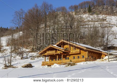 Wooden Chalet In Winter