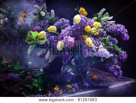 Lilac And Tulips In A Transparent Jug