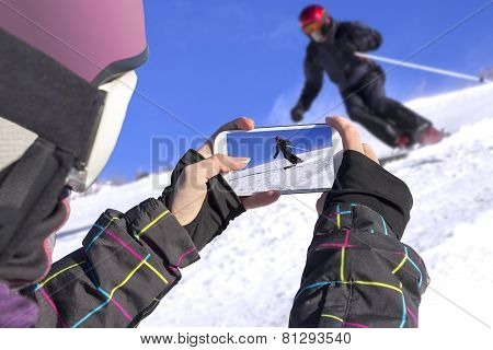 Photographed Skiers With Mobile Phone