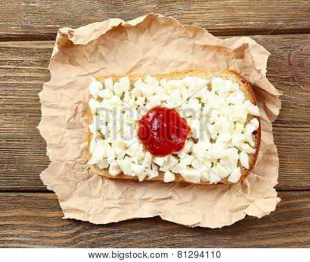 Sandwich with flag of Japan on table close-up