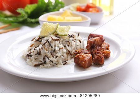 Tasty rice with meat served on table, close-up
