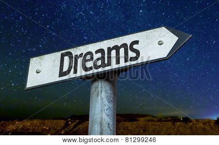 Dreams sign with a beautiful night background