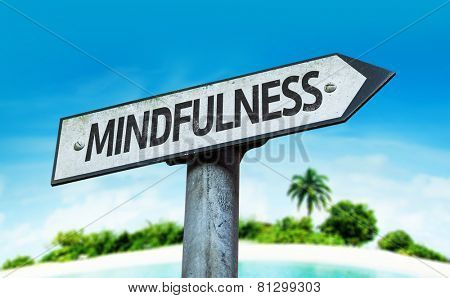 Mindfulness sign with a beach on background