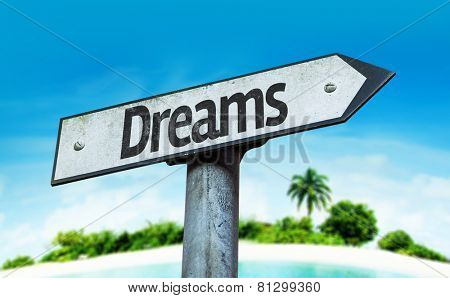 Dreams sign with a beach on background