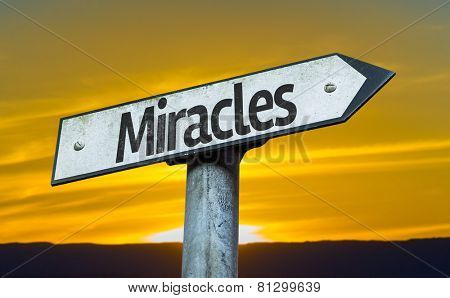 Miracles sign with a sunset background