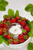 stock photo of dipping  - Fresh strawberries with vanilla cream cheese dip - JPG