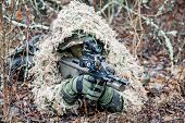 foto of raid  - Jagdkommando soldier Austrian special forces wearing a ghillie suit - JPG
