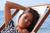picture of asian woman  - Beautiful asian woman by the sea in Greece - JPG