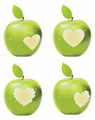 image of love bite  - Fresh green apple with heart shaped bite - JPG