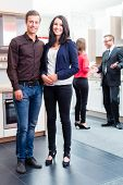 pic of showrooms  - Couple buying in kitchen in store showroom - JPG