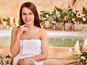 stock photo of bath tub  - Woman relaxing at water spa - JPG