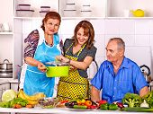 stock photo of grandmother  - Big family cooking at kitchen - JPG