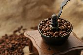 image of coffee crop  - Vintage manual coffee grinder with coffee beans isolated - JPG
