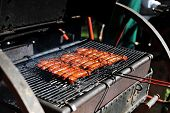 picture of frizzle  - few tasty meat sausages cooking on grill - JPG