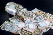 Постер, плакат: Ukrainian money in the jar