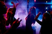 stock photo of club party  - Group of dancing young people enjoying night in club - JPG