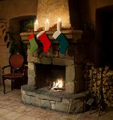 picture of chimney  - Christmas stocking on fireplace background. Chimney candles and woodpile. Chimney place. ** Note: Soft Focus at 100%, best at smaller sizes - JPG