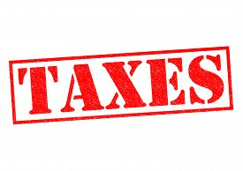 stock photo of tariff  - TAXES red Rubber Stamp over a white background - JPG