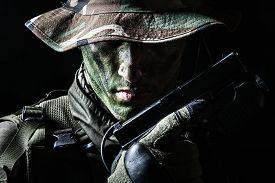 pic of pistols  - Jagdkommando soldier Austrian special forces with pistol on dark background - JPG