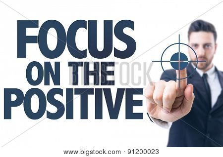 Business man pointing the text: Focus on the Positive