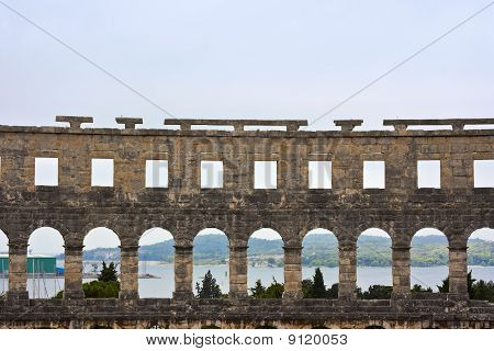 Amphitheater And Harbor In Pula