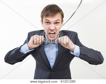 Angry businessman on the chain with a collar.