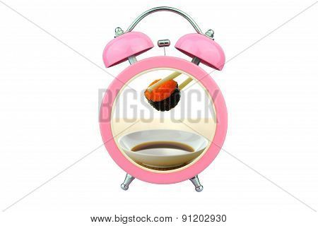 Conceptual Art : Sushi Time : Holding Shrimp Eggs Sushi And Sauce Within Pink Alarm Clock Isolated O