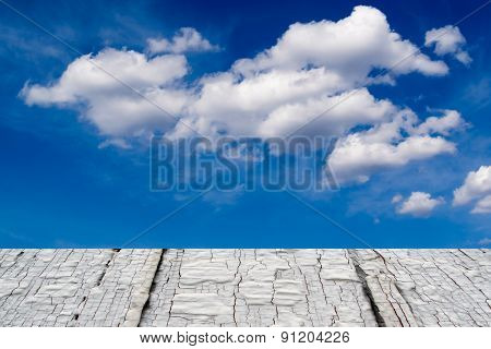 White Cloudscape And Aged Timber