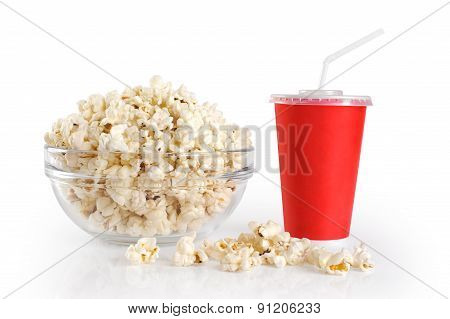 A Bowl Of Popcorn And A Paper Cup