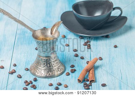 cup of coffee turk and coffee beans