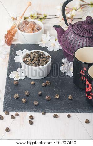 Asian Tea Set With Dried Green Tea And Sugar