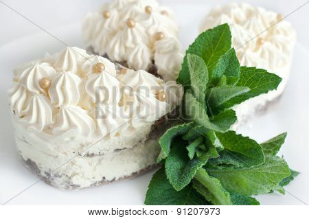 Cakes On A Plate With Mint. Desert