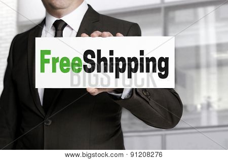 Freeshipping Sign Is Held By Businessman