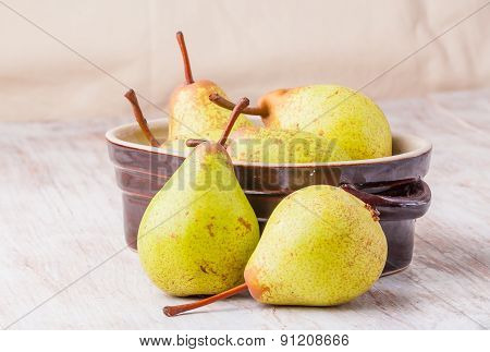 Pears In Bowl On A Wooden Table.