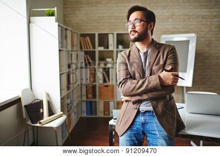 Asian businessman having short break in office