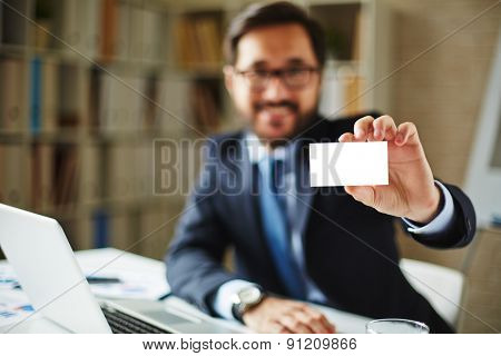Hand of businessman holding blank card