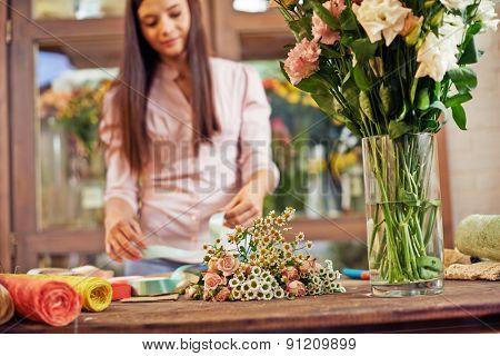 Floral designer working in shop of floristics
