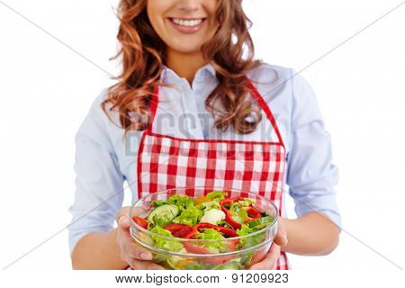 Happy girl holding bowl with fresh vegetable salad