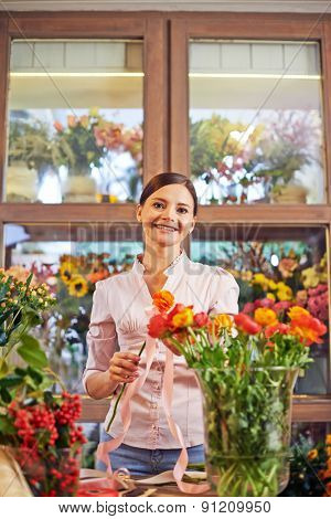 Happy female florist looking at camera with smile