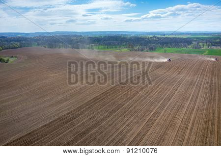 Aerial View Of The Tractor Harrowing The Field
