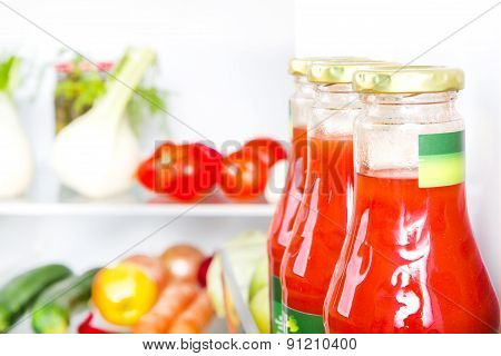 Bottle Of Tomato Juice With Fruits And Vegetables At Background