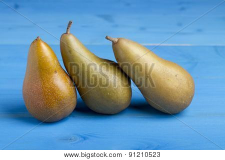 Pears on Blue Wooden Background