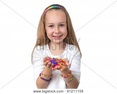 Loom bands craft. Little girl holding colourful loom in her hands