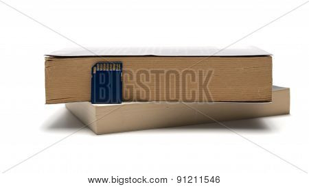 Sd Card With Stack Of Book