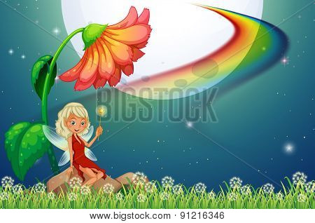 Fairy sitting on a rock under the flower